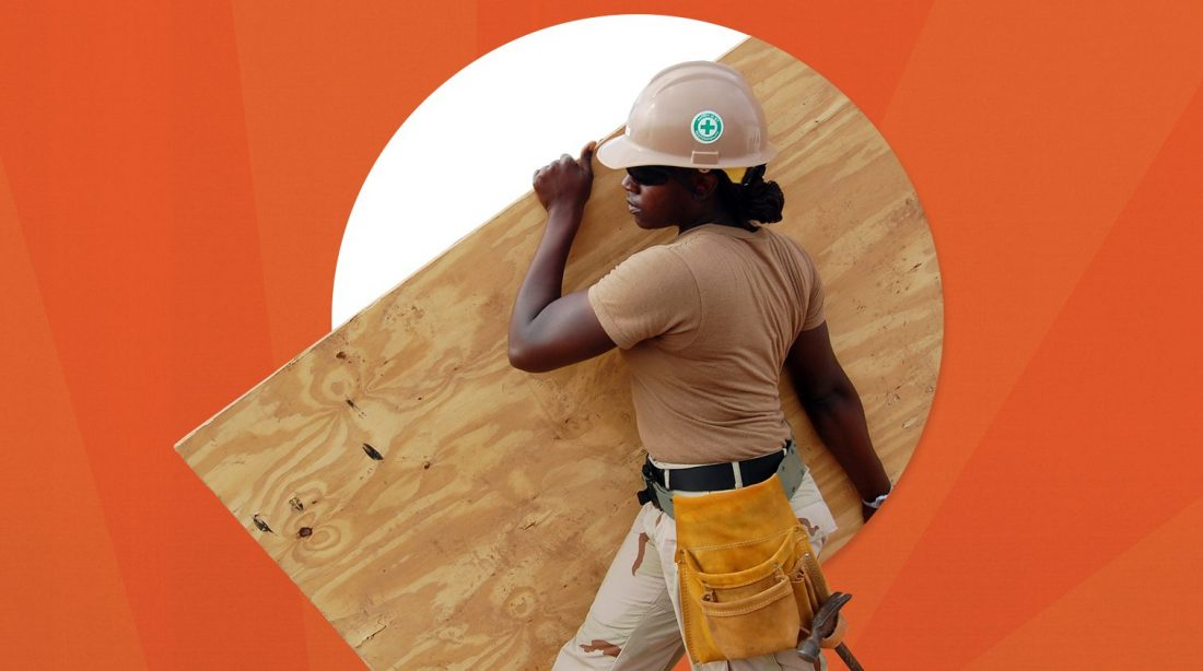 A black woman working on a construction site.