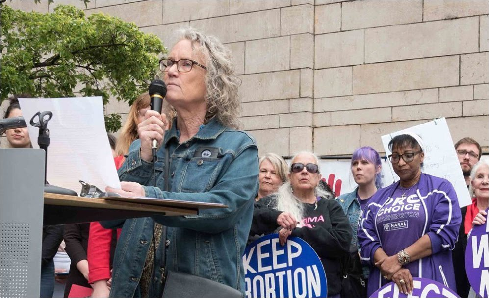 Helen Gilbert speaks for Radical Women at Stop the Bans Rally in Seattle.