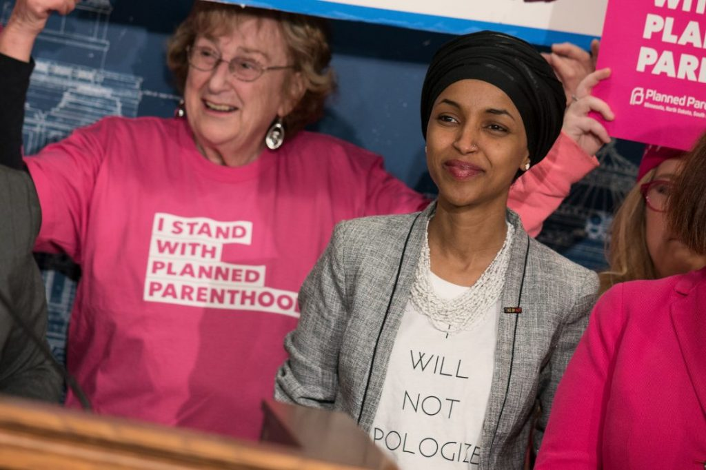 Ilhan Omar with a Planned Parenthood activist