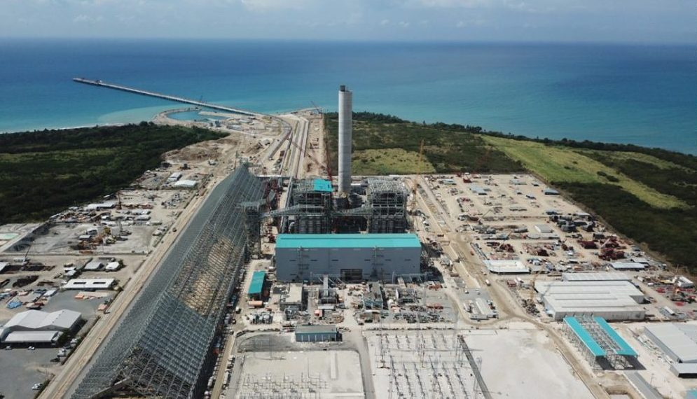 View of the beach and ocean from above the Punta Catalina coal thermal power plant and port.