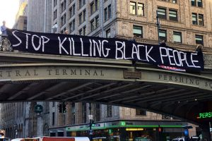 "Banner that reads ""Stop Killing Black People"""