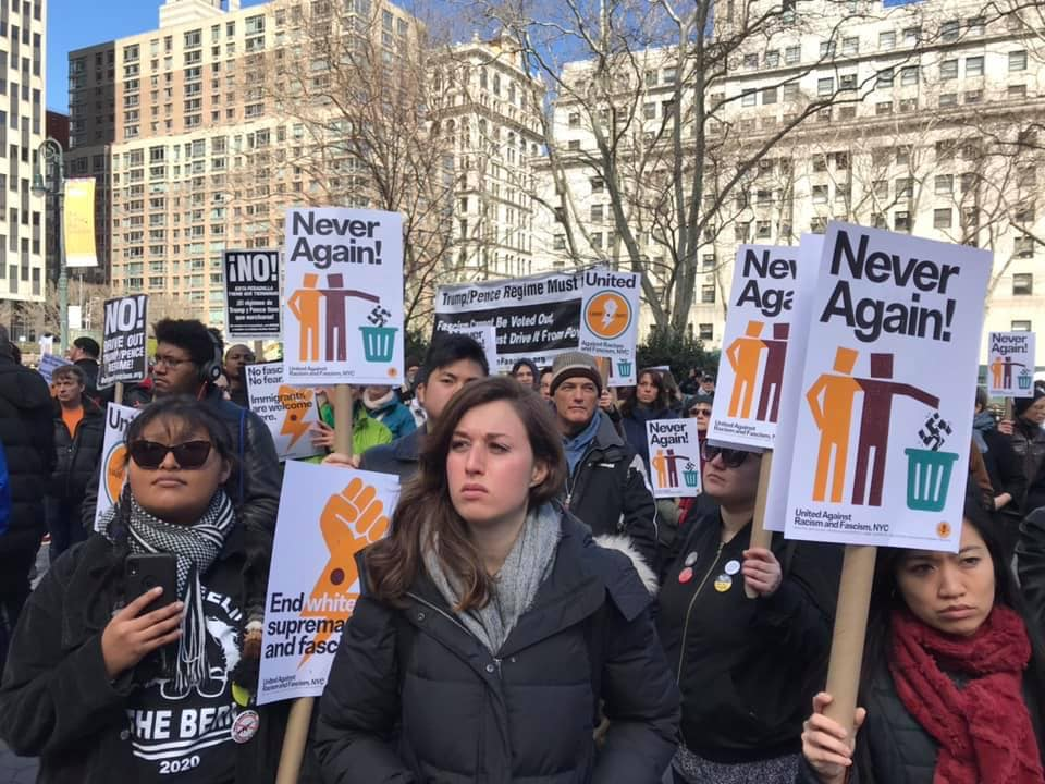"Protestors holding signs that say ""Never Again!"""