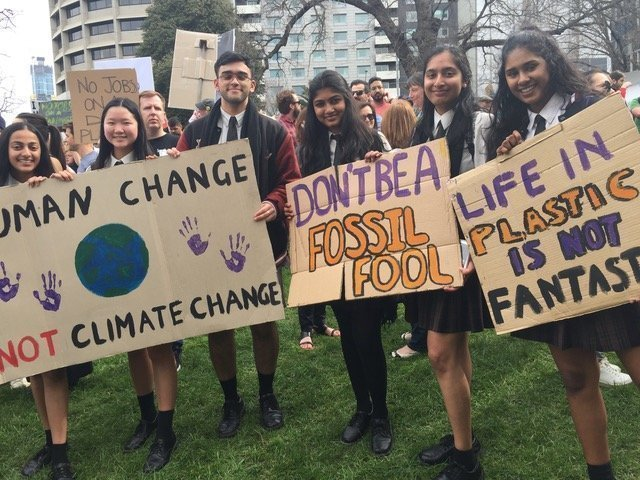 High school students hold signs during the 2019 Climate Strike in Melbourne