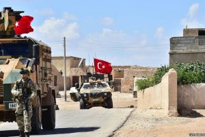 Turkish soldiers with their vehicles conduct patrols outside Manbij, Syria.