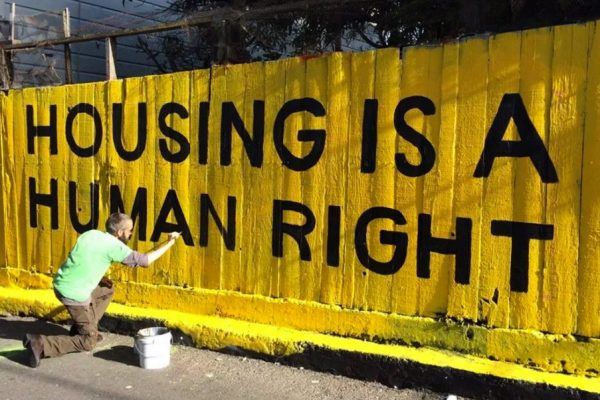"Mural that says ""HOUSING IS A HUMAN RIGHT"""