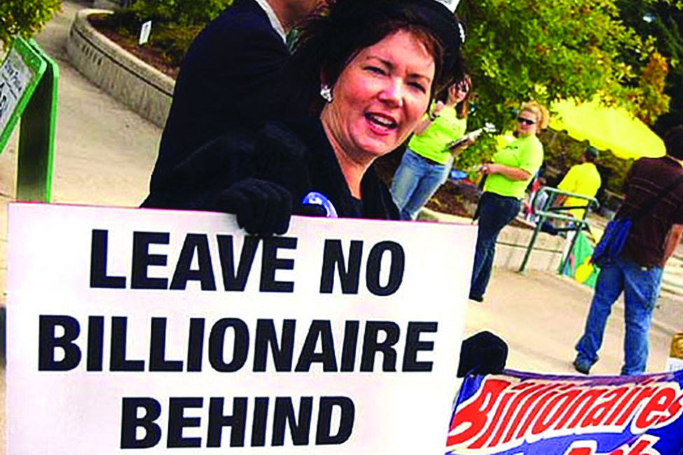 Woman with sign reading