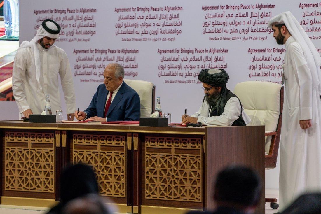 US representative Zalmay Khalilzad (left) and Taliban representative Abdul Ghani Baradar (right) sign a peace agreement in Doha, Qatar on February 29, 2020.